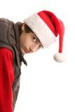 De jongen die van Kerstmis over buigt Stock Afbeeldingen