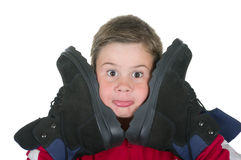 De jongen drukt laarzen aan de persoon royalty-vrije stock afbeelding