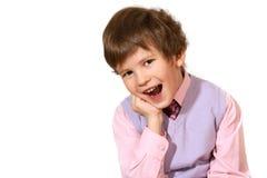 De jongen in een roze overhemd Stock Afbeelding