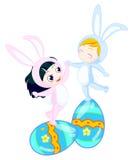 De jongen en het meisje van het konijntje Stock Foto's