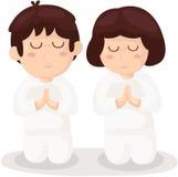 De jongen en het meisjes het bidden van het beeldverhaal Stock Foto's