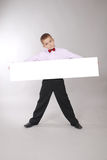 De jongen houdt witte raad Stock Foto's