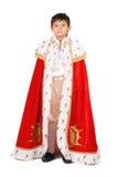 De jongen kleedde zich als koning. Geïsoleerdn Stock Afbeelding