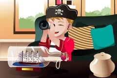 De jongen kleedde zich in een piraatuitrusting royalty-vrije illustratie