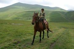 De jongen op het paard Royalty-vrije Stock Foto's