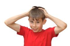 De jongen toont emotiegebaren Stock Foto