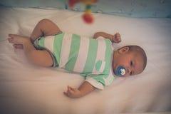 De Jongen van de baby in Voederbak royalty-vrije stock foto