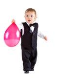 De jongen van de baby in leeftijd de ballon van de één jaarholding Royalty-vrije Stock Fotografie