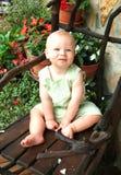 De Jongen van de baby met Bloemen royalty-vrije stock afbeelding