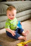 De Jongen van de baby met Speelgoed stock afbeeldingen