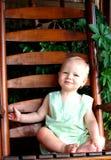 De Jongen van de baby op Portiek stock foto's