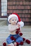 De jongen van de baby in santahoed Stock Afbeelding