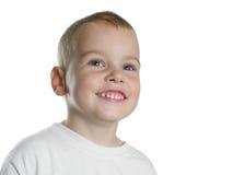De jongen van de glimlach op wit royalty-vrije stock afbeeldingen