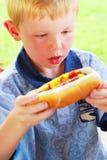 De Jongen van de hotdog Royalty-vrije Stock Afbeeldingen