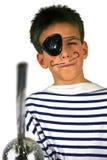 De jongen van de piraat bij partij stock foto