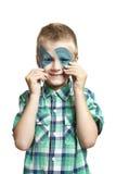 De jongen van de school met tekendriehoek en gradenboog Stock Fotografie