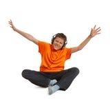 De jongen van de tiener het luisteren muziek Royalty-vrije Stock Afbeeldingen