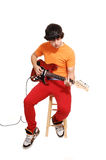 De jongen van de tiener met gitaar. Royalty-vrije Stock Foto's