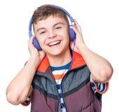 De jongen van de tiener met hoofdtelefoons Royalty-vrije Stock Afbeeldingen