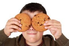 De jongen van de tiener met koekjes Stock Fotografie