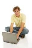 De Jongen van de tiener op Computer Stock Afbeeldingen