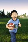 De jongen van de voetbal Stock Afbeelding