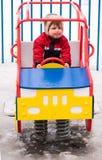 De jongen van de winter op speelplaats Stock Foto
