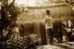 De jongen van het dorp stock foto's