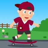 De Jongen van het skateboard in het Park Stock Foto