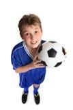 De jongen van het voetbal Stock Foto's