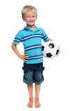 De jongen van het voetbal in studio stock afbeelding