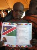 De jongen van Himba met antem van Namibië Royalty-vrije Stock Foto