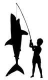 De jongen vangt haai Stock Foto's
