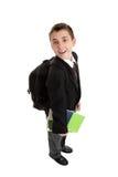 De jongens dragende zak en boeken van de middelbare school stock afbeeldingen