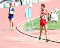 De jongens op de 10.000 meters ras lopen Stock Afbeeldingen