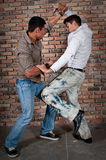 De jongens van de straat vechten Stock Foto's