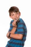 De jongensholding friemelt spinner stock foto