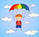 De jongensparachutist daalt van de hemel op een valscherm door Royalty-vrije Stock Afbeelding