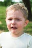 De jongensschreeuwen Stock Afbeelding