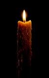 De kaars van lit op zwarte Stock Foto