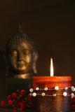 De kaars van Zen en het standbeeld van Boedha Stock Afbeelding