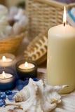 De kaarsen en shell van het kuuroord Stock Afbeelding