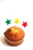 De kaarsen van de muffin en van de ster Stock Afbeeldingen