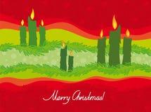De kaarsen van Kerstmis op een rode achtergrond Royalty-vrije Stock Fotografie