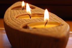 De kaarsen van lit in een houder Royalty-vrije Stock Foto's
