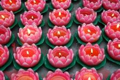 De kaarsen van Lotus in tample Stock Fotografie