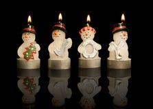 De Kaarsen van sneeuwmannen Stock Foto's