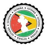 De kaart en de vlag van Guyana in uitstekende rubberzegel van Stock Afbeelding