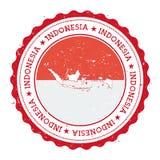 De kaart en de vlag van Indonesië in uitstekende rubberzegel van Stock Afbeeldingen