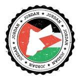 De kaart en de vlag van Jordanië in uitstekende rubberzegel van Royalty-vrije Stock Foto's